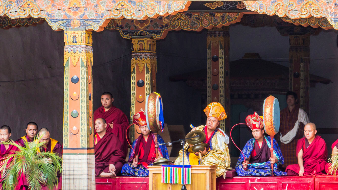 The band is playing for the dancers at drupchen festival in the dzong of Punakha, Bhutan.